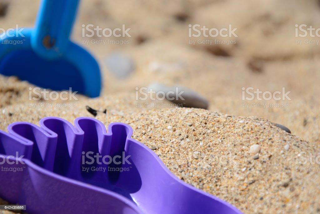 Детский набор для игры с песком на берегу моря stock photo