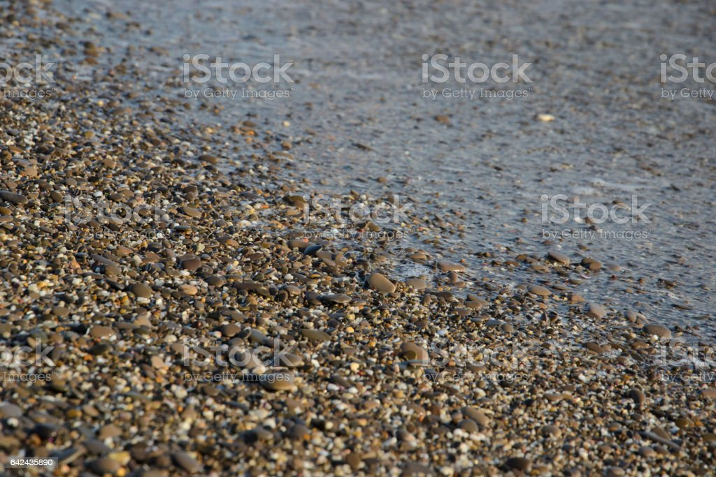 галька на пляже в качестве фона stock photo