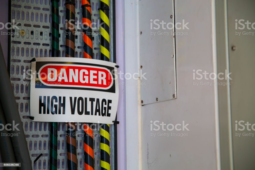 DANGER HIGH VOLTAGE ELECTRIC CABLES stock photo