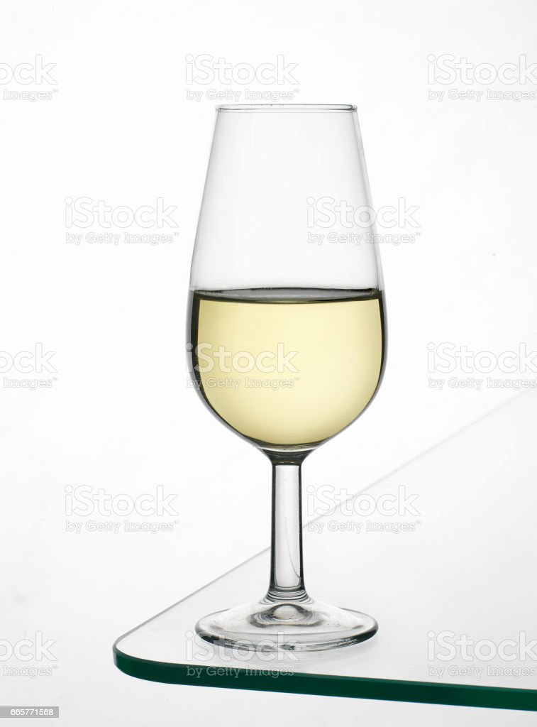 CUP OF FINE WINE OF ANDALUCIA, WITH INTENSE YELLOW COLOR, TYPICAL OF A MONTLLA-MORILES AND JEREZ AREA stock photo