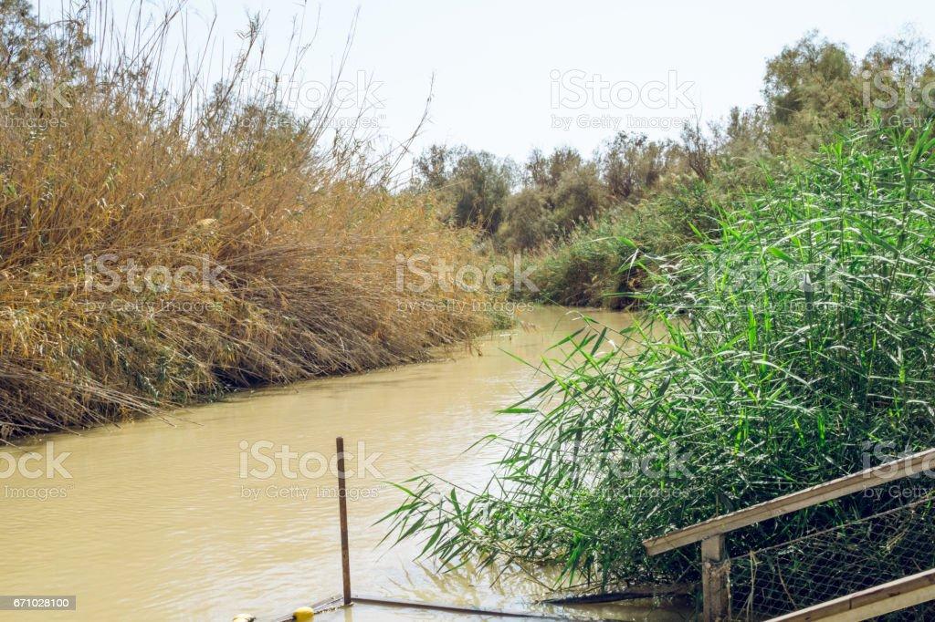 Река Иордан в жаркий полдень. Граница Иордании и Израиля stock photo