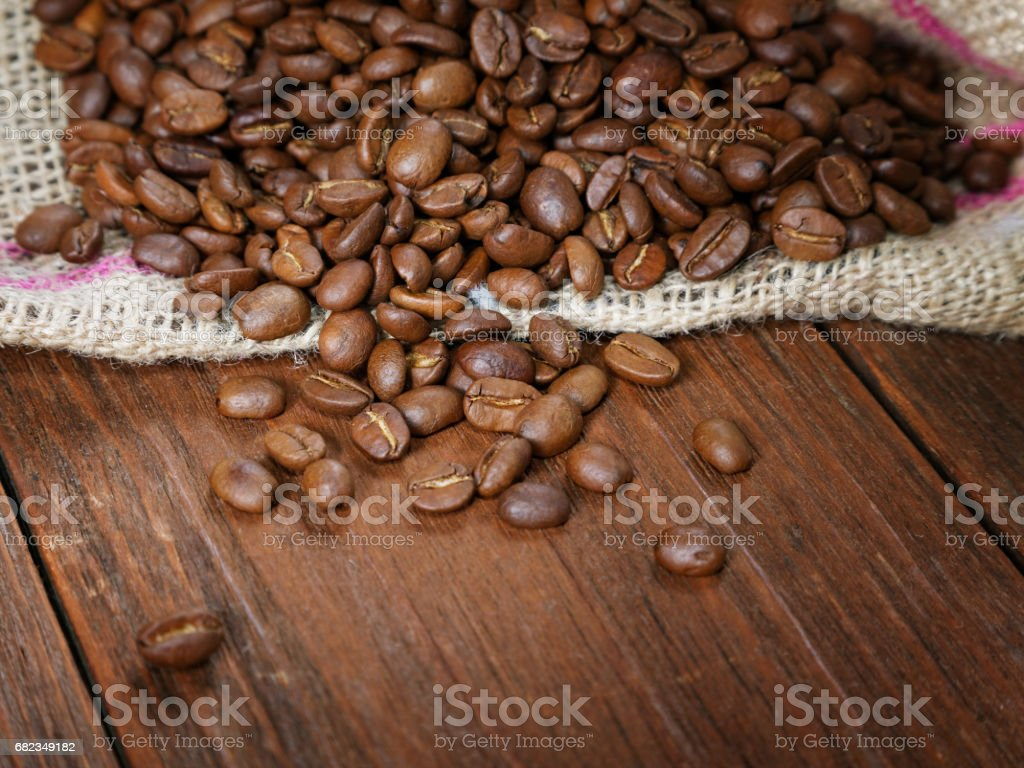COFFEE GRAIN IN A BAG ON A RURAL TABLE stock photo