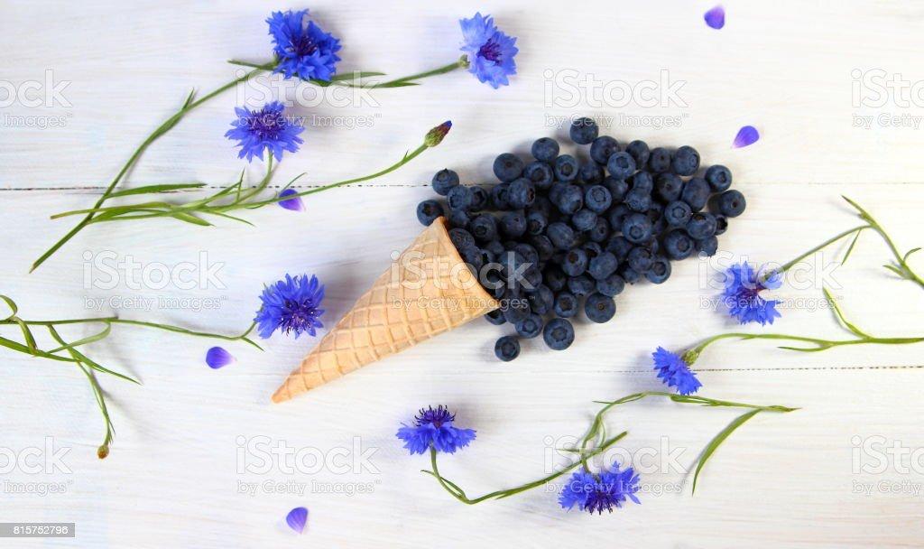 голубика в вафельном стаканчике stock photo