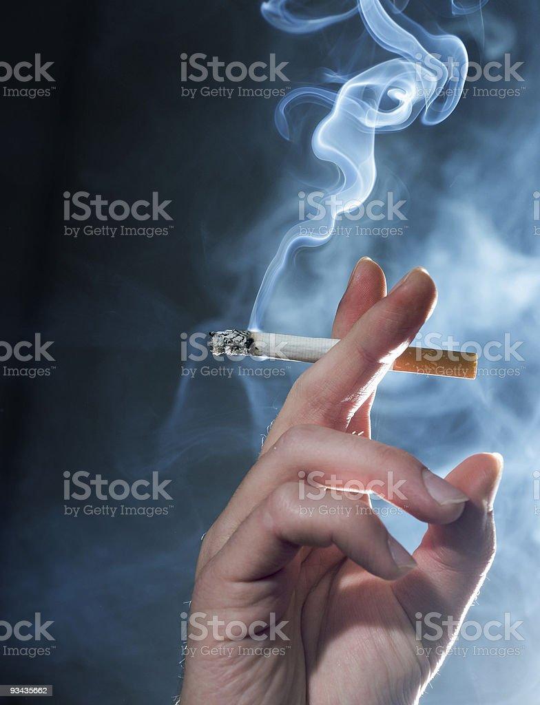 HAND CIGARETTE SMOKE stock photo