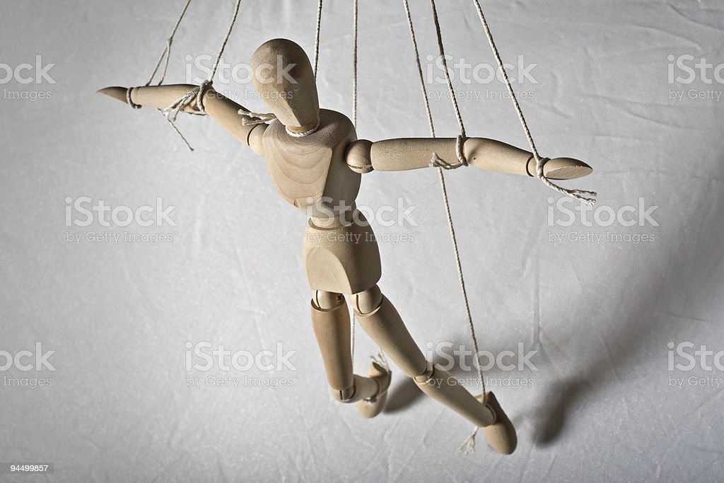 MARIONETTE HANGING ON STRINGS stock photo