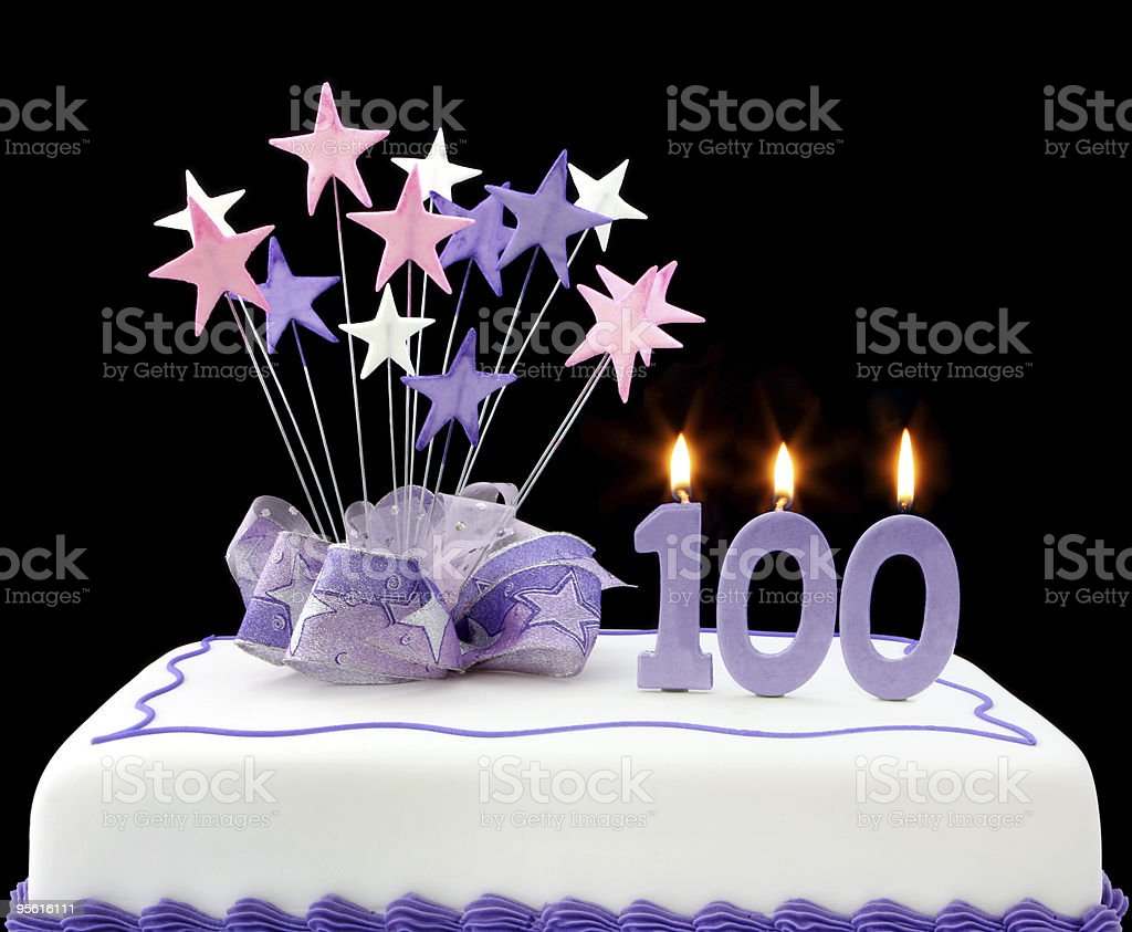 100th birthday purple and white cake stock photo