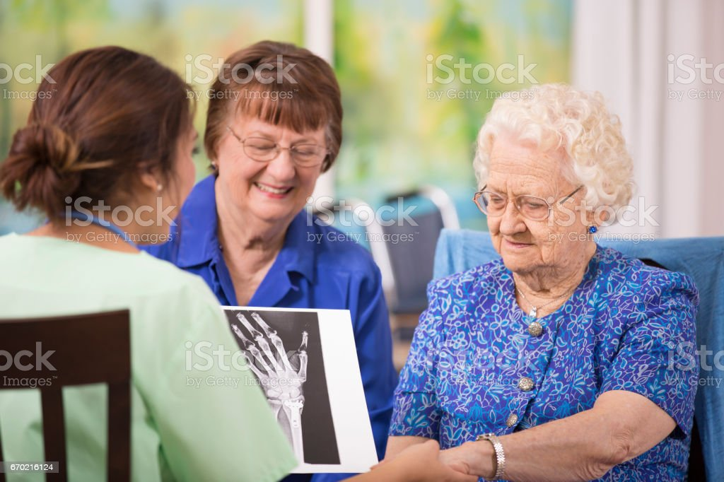 100-Year-Old woman and her home healthcare nurse. stock photo