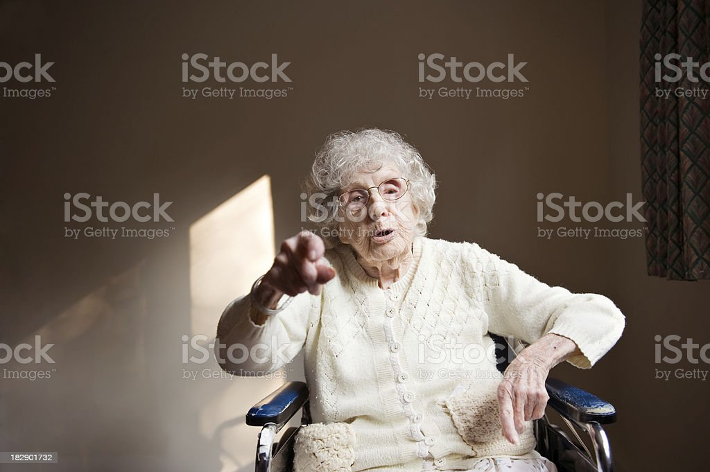 103-Year-Old Woman Points at Camera stock photo