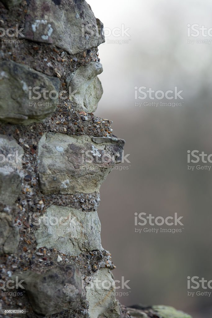 12th Century old brick and flint wall stock photo