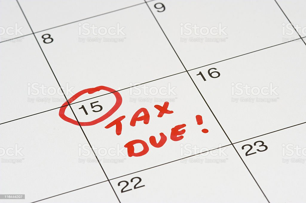 15th day on calendar circled and marked with TAX DUE  stock photo