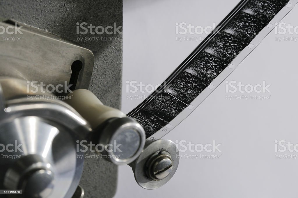 16mm film in projector stock photo
