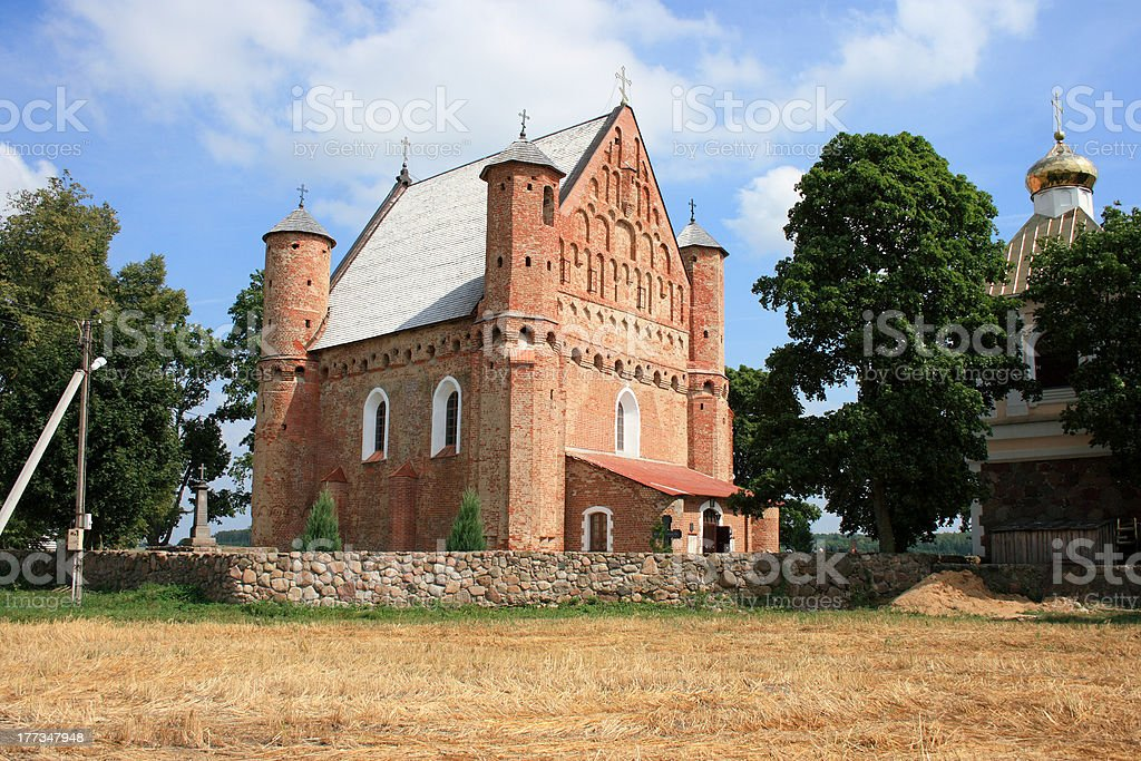 16th century fortified church in Belarus village stock photo