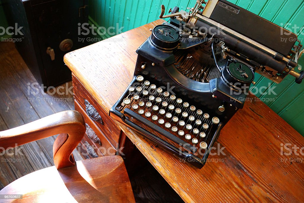 1800s Style Typewriter on Antique Desk with Chair royalty-free stock photo