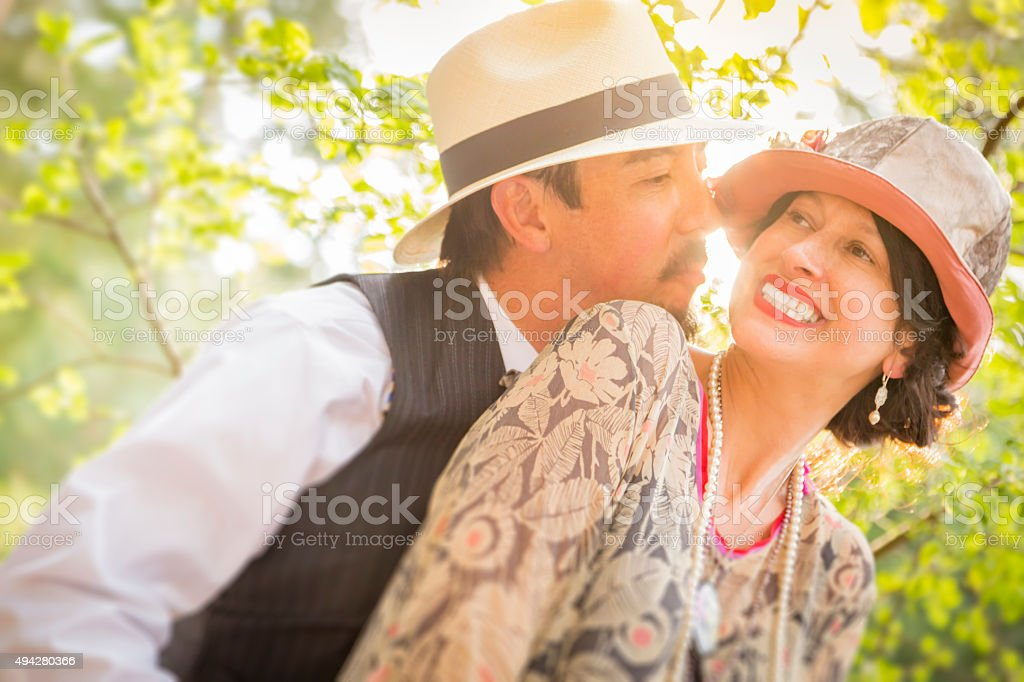1920s Dressed Romantic Couple Flirting Outdoors stock photo