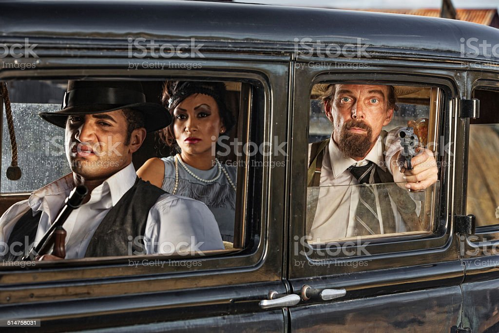 1920s Era Gangsters Drive By stock photo