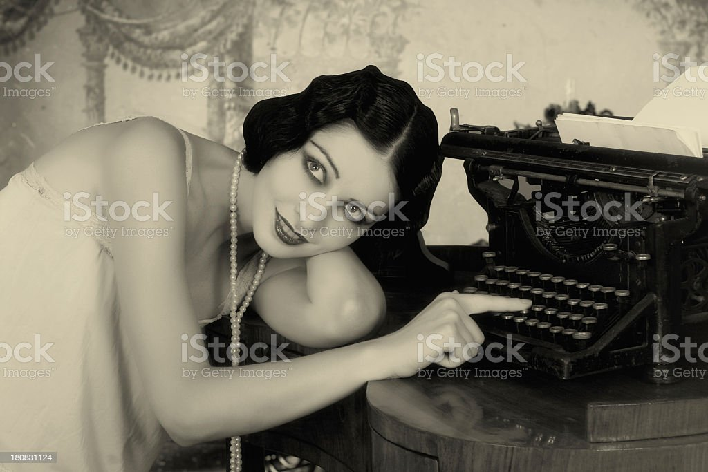 1920s flapper woman posing beside latest technology stock photo
