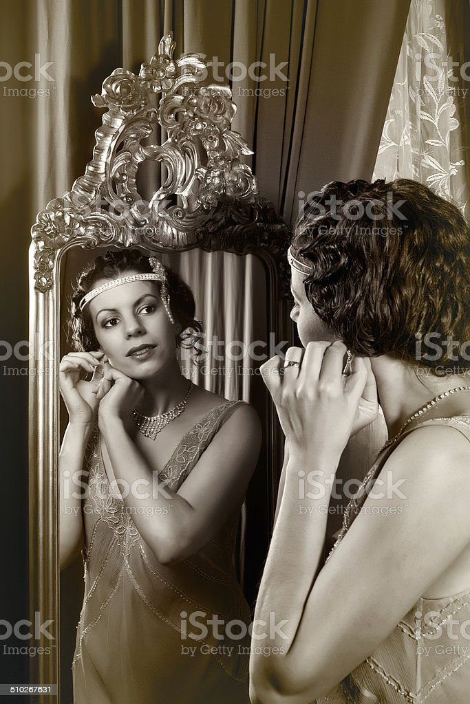 1920s lady in mirror stock photo