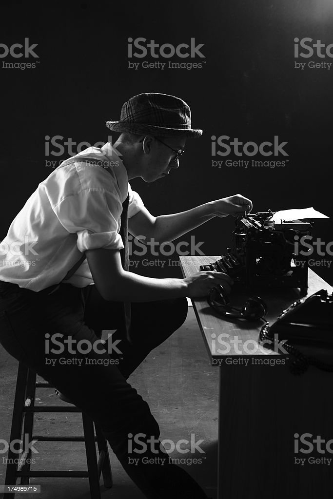1920s Reporter Working Late Hours on Breaking News Story stock photo