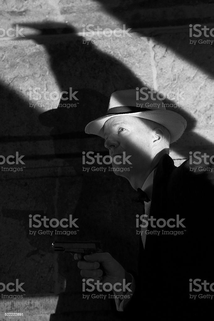 1940s gangster character with raven shadow stock photo