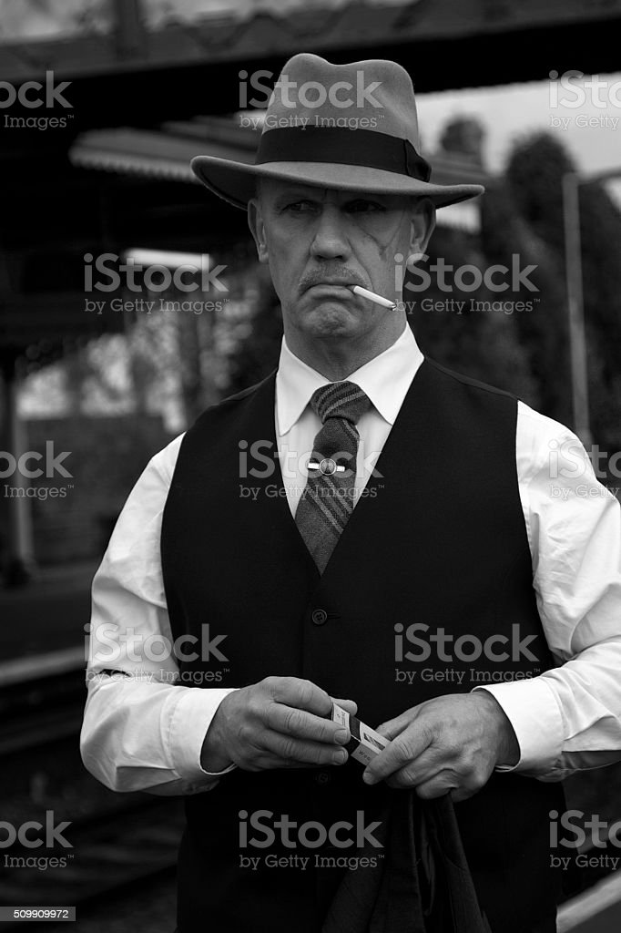 1940s male standing on a train platform stock photo