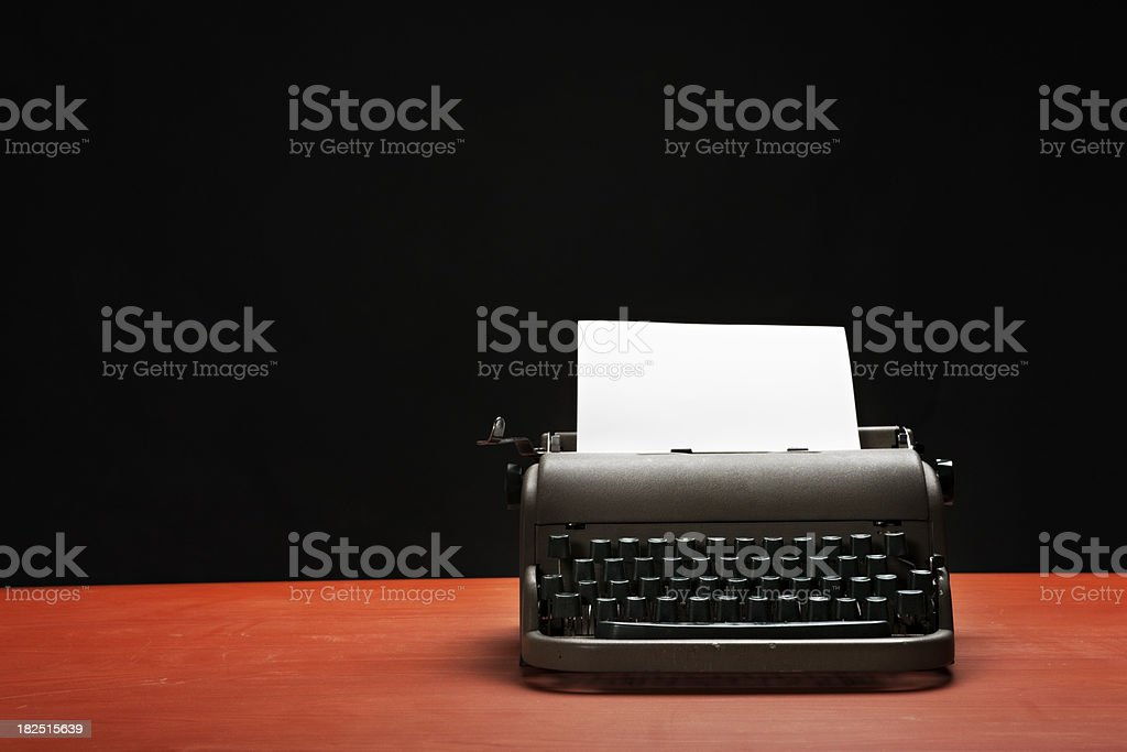 1940s typewriter with blank paper waits for inspiration to strike royalty-free stock photo