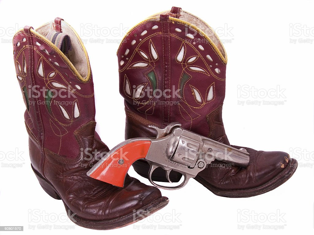 1950 criança cowgirl botas e cap pistola foto royalty-free