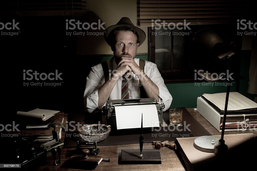 1950s journalist working late at night stock photo