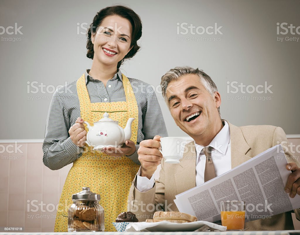 1950s style couple having breakfast stock photo