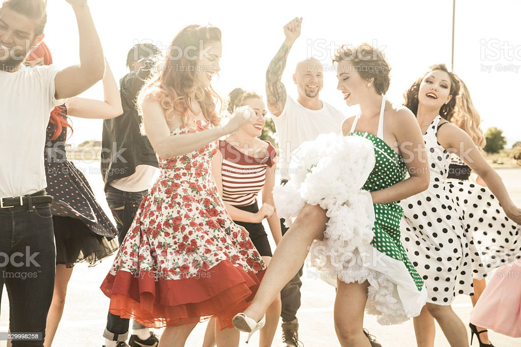 1950s Style People Dancing Outside stock photo