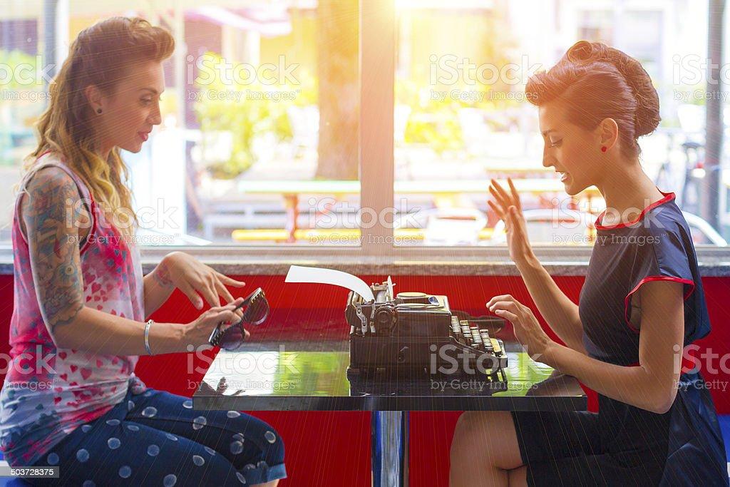 1950s style - Two women talking stock photo