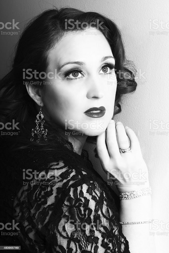 1950s styled woman gazing off in apparent alarm. stock photo