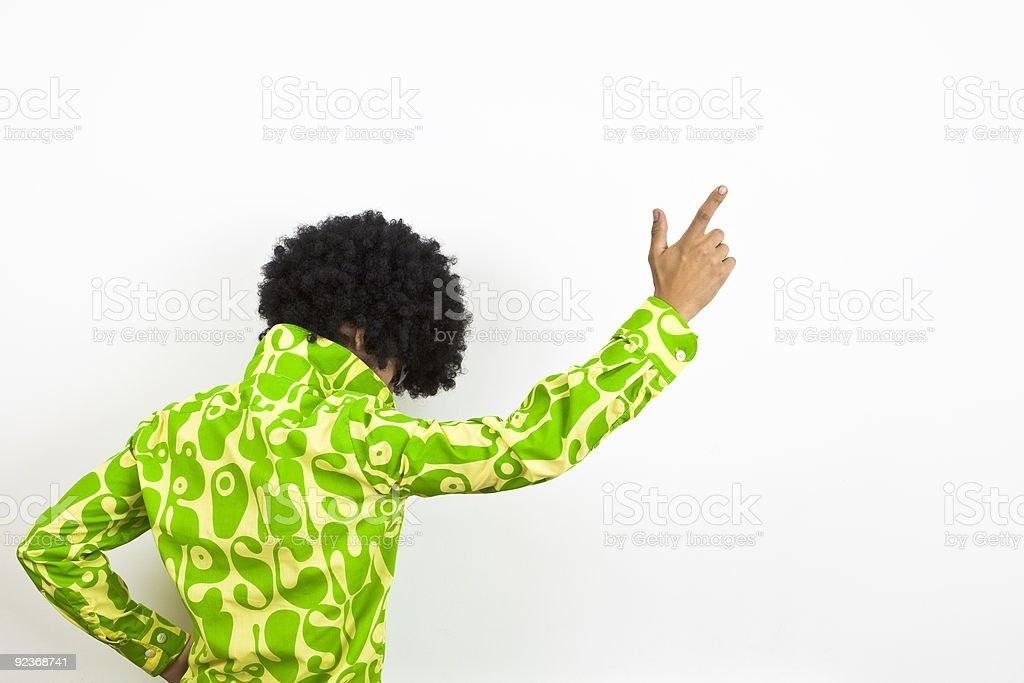 1970s styled disco dude points upward. stock photo