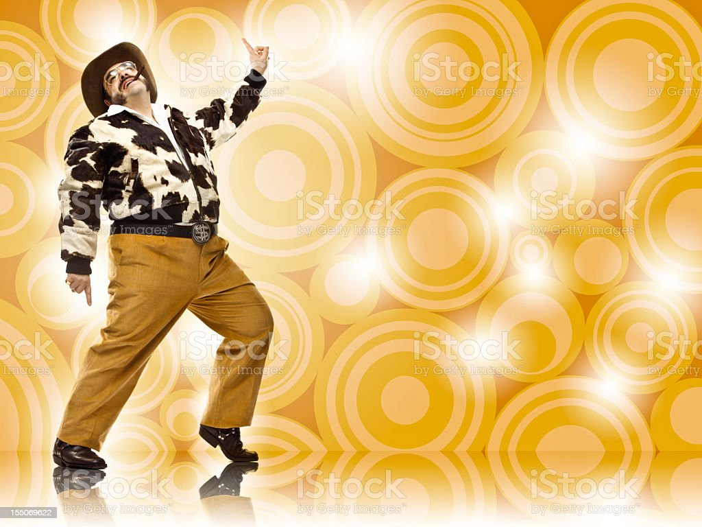 1970s vintage rich cowboy disco dance move on brown stock photo