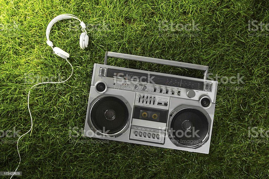 1980s Silver radio boom box  on green grass stock photo
