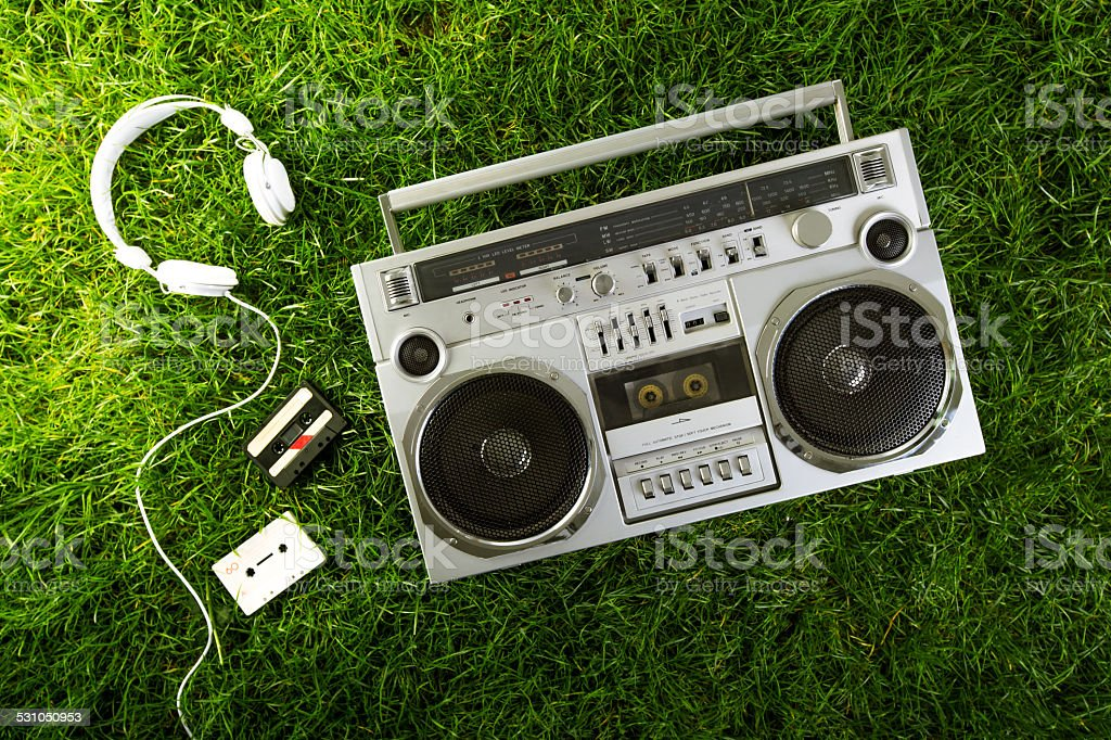1980s Silver radio boom box  on green grass stock photo