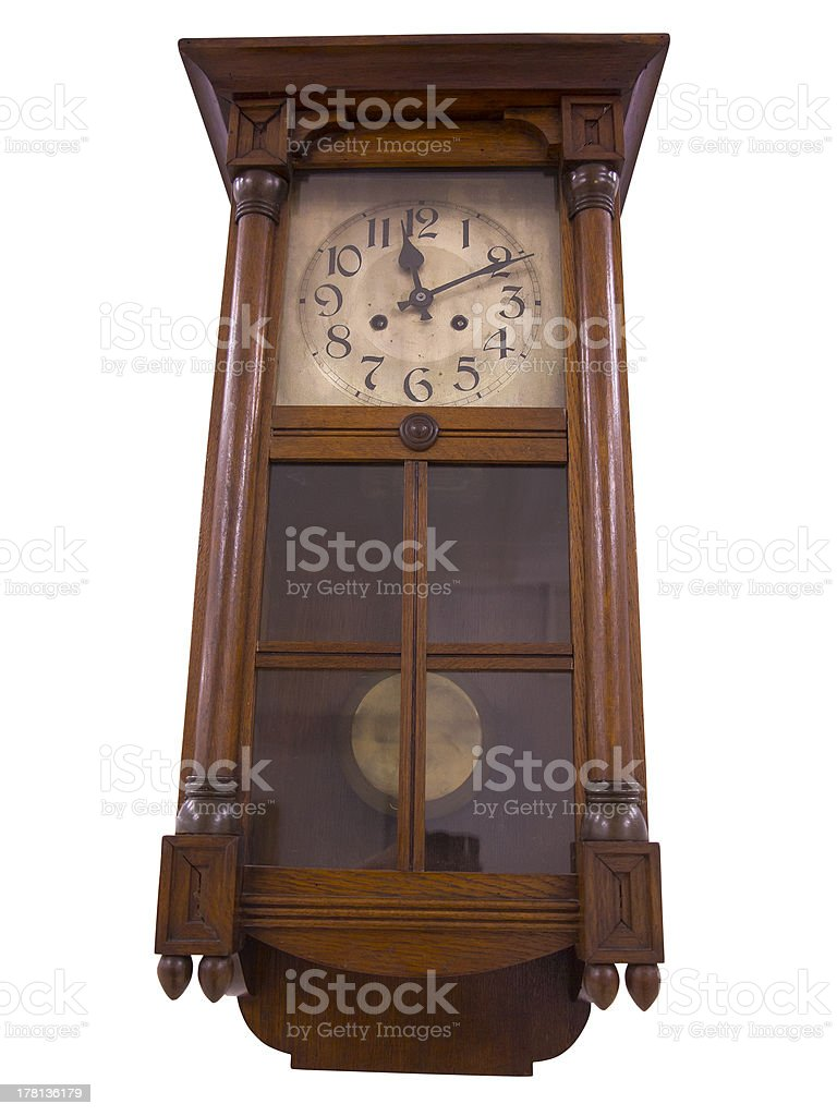 19th Century old pendulum wooden clock isolated on white royalty-free stock photo