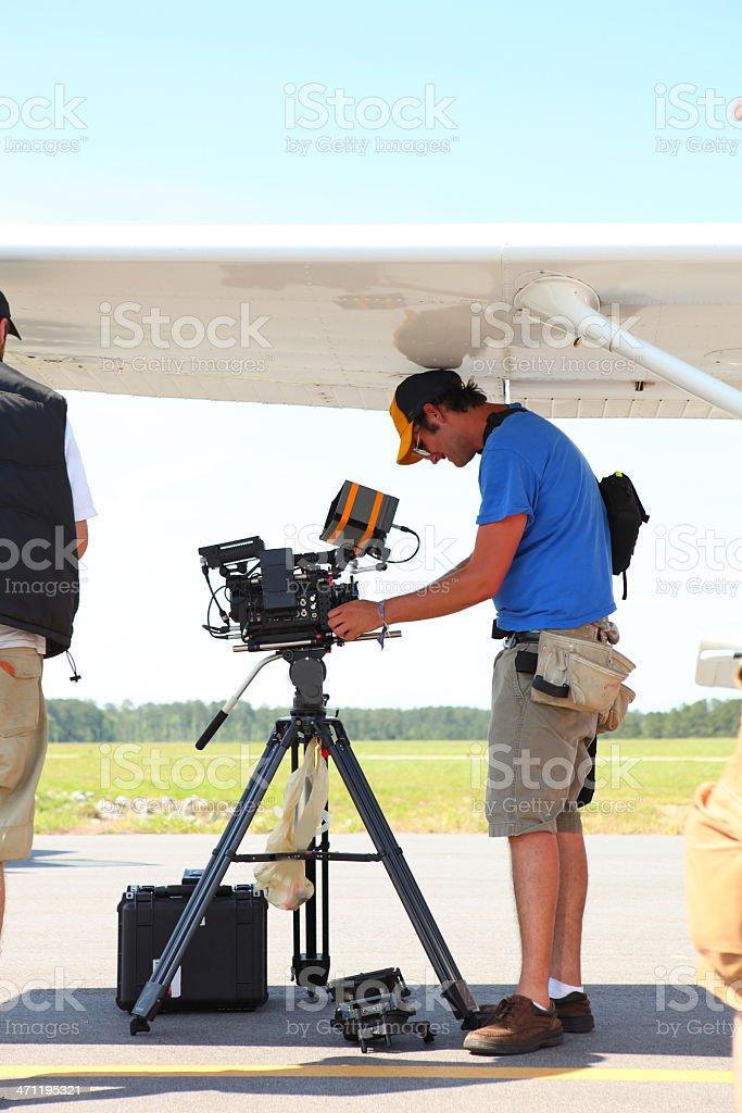 1st AC Setting Up Camera stock photo