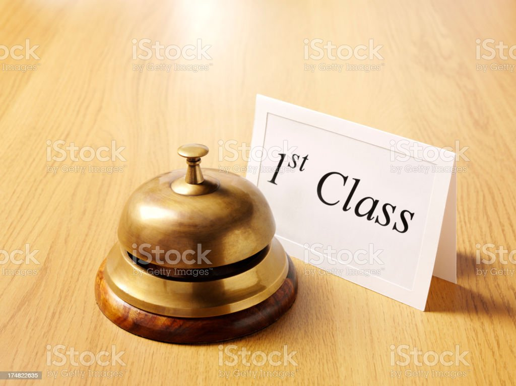 1st Class Card by the Concierge Bell royalty-free stock photo