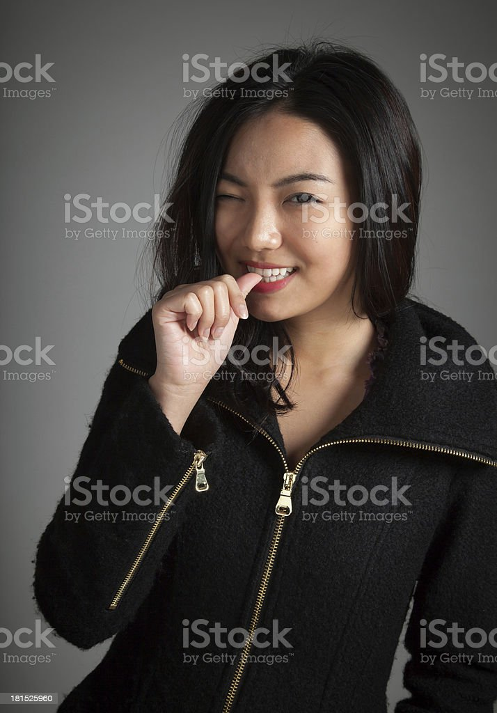 20s Attractive Asian girl wearing a hoodie on grey background royalty-free stock photo