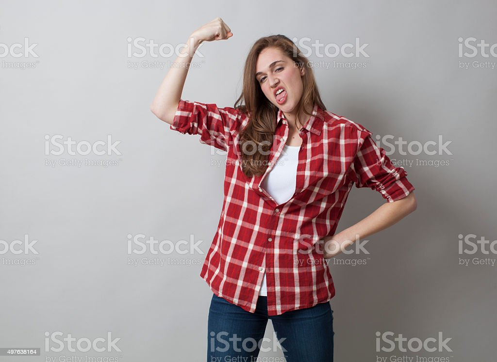 20s woman playing idiot with butch attitude for gender independance stock photo