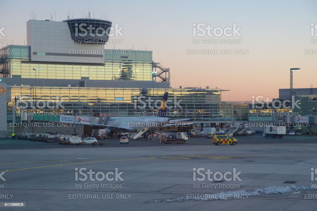 FRANKFURT, GERMANY - JAN 20th, 2017: Aircrafts, an Airbus from Lufthansa, at the gate in Terminal 1 at Frankfurt International Airport FRA during sunset. Terminal 1 was completed in 1972 and houses Lufthansa and other Star Alliance partners stock photo