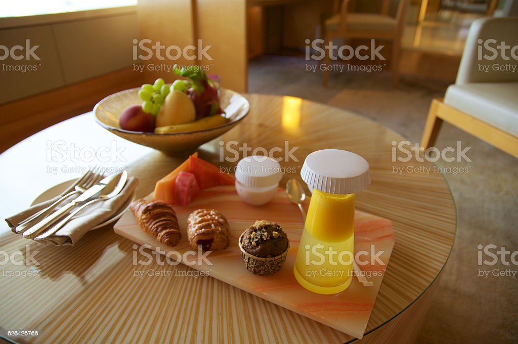 SINGAPORE - JULY 23rd, 2016: Welcome treatment drink and fruits stock photo