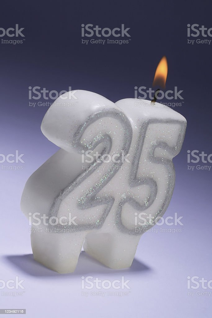 25th wedding anniversary or birthday candle stock photo