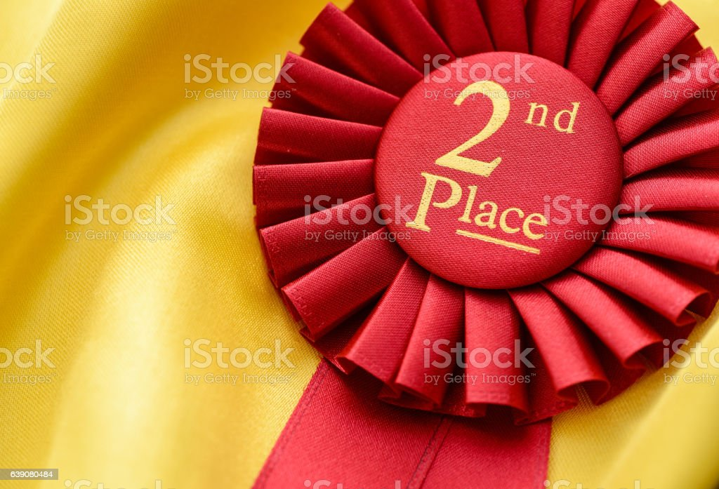 2nd place red winners rosette with pleated ribbon stock photo