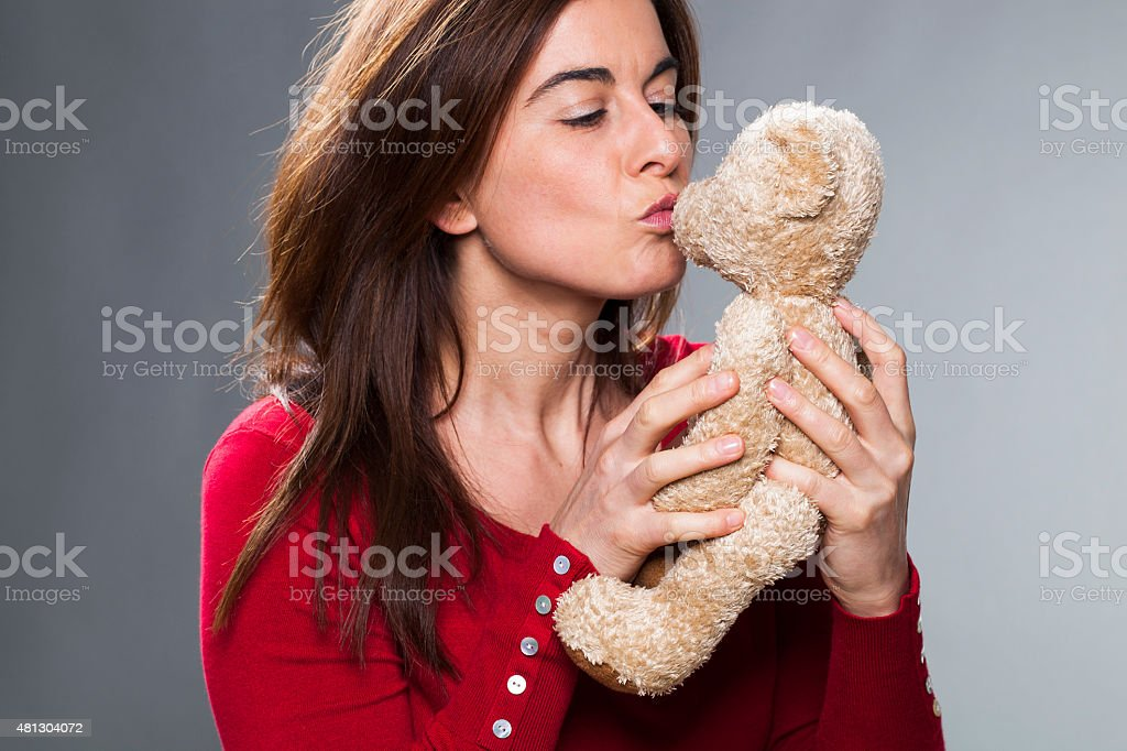 30s girl using a symbol of childhood for baby announcement stock photo