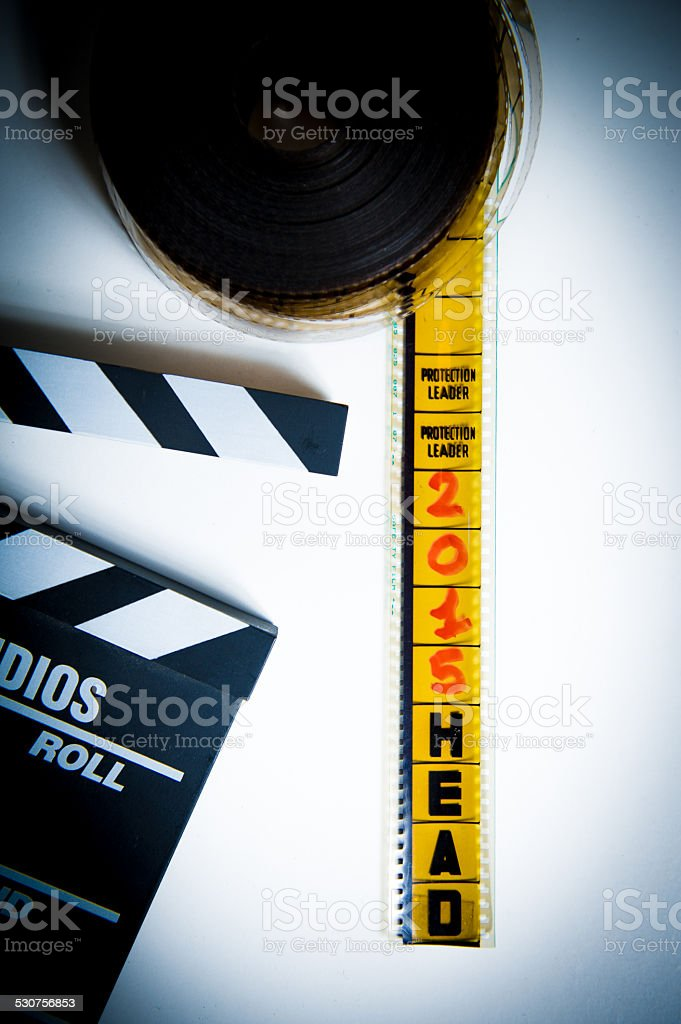 35mm film head of reel with '2015' frame and clapper stock photo
