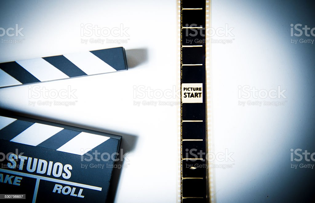 35mm film head of reel with 'picture start' and clapper stock photo
