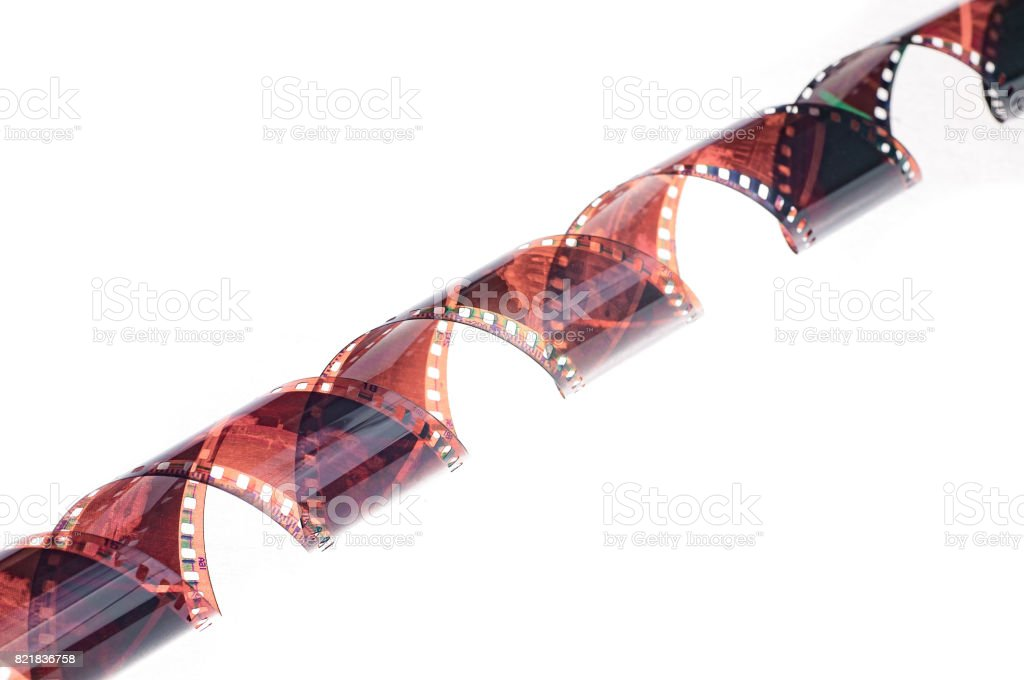35mm film strip over white background stock photo