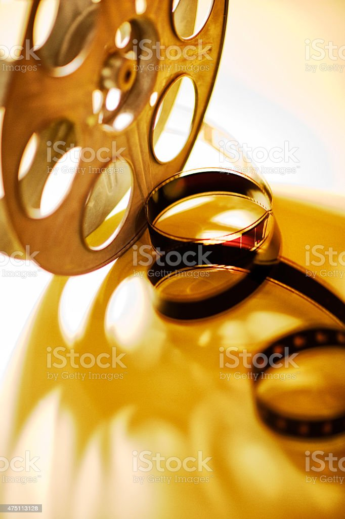 35mm movie film with metal reels. stock photo