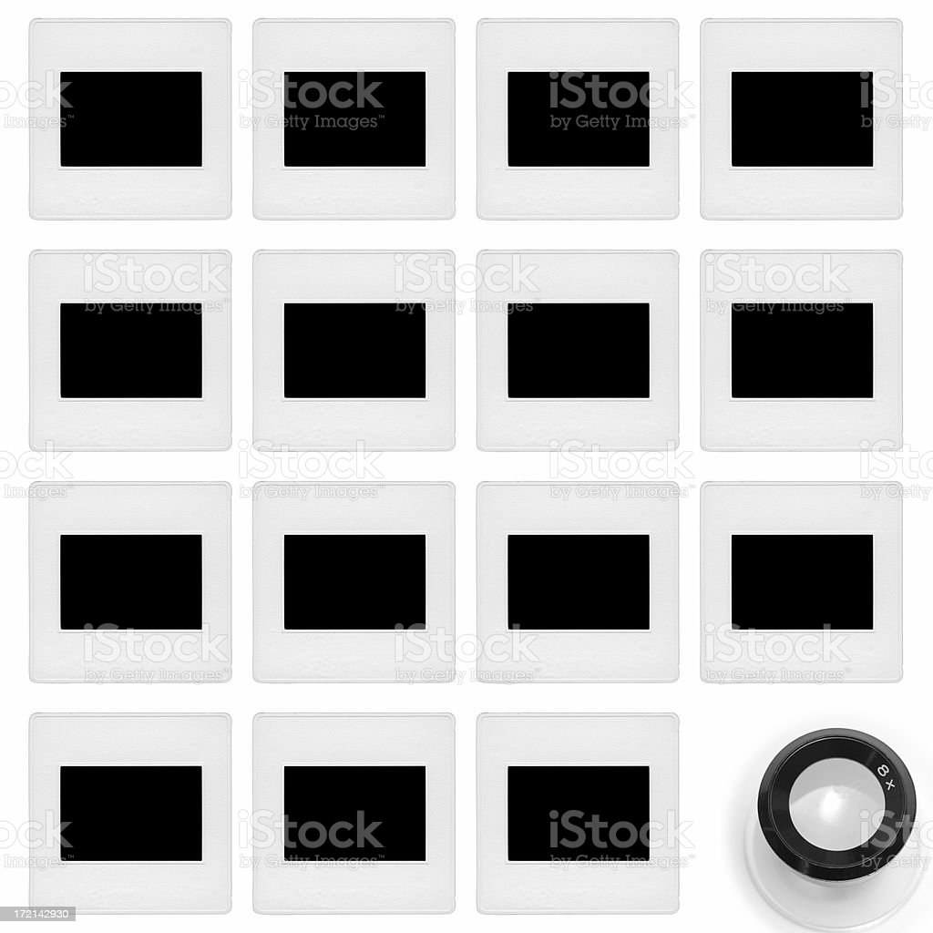 35mm Slides on Table with Loupe royalty-free stock photo
